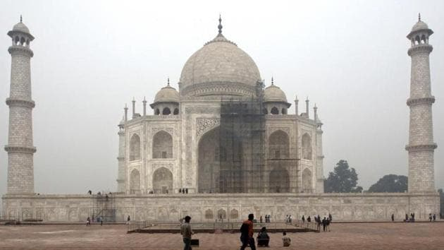 File photo of workers cleaning the Taj Mahal in Agra.(AP)