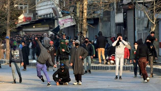 Protesters throw stones at security forces during a demonstration against the killing of three civilians allegedly in Army firing in Shopian district on January 27.(PTI)