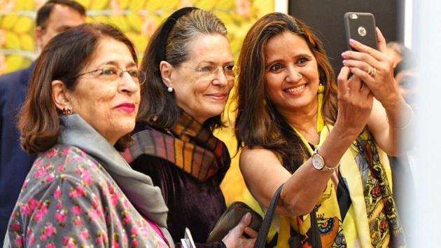 UPA Chief Sonia Gandhi gets a selfie clicked with spectators during the India Art Fair 2018 at Okhla NSIC Grounds, New Delhi. (Raj K Raj / HT Photo)