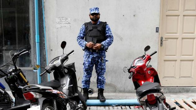 A security personnel stands guard on the streets of the Maldives capital Male.(AFP Photo)