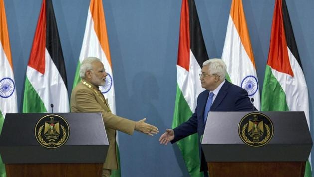 Prime Minister Narendra Modi shakes hands with Palestinian President Mahmoud Abbas following a joint statement at the end of their meeting at the Palestinian Authority headquarters in the West Bank city of Ramallah on February 10.(AP Photo)
