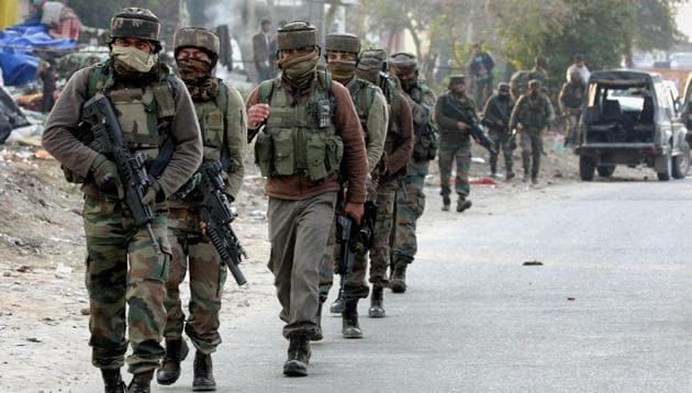 Security personnel take positions during a militants attack at Sunjwan Army camp in Jammu on Saturday.(PTI)
