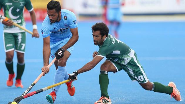 Harmanpreet Singh of India and Ali Shan of Pakistan battle for possession during the 5th-8th place match of the Hockey World League semi-final in London on June 24, 2017. Pakistan have qualified for the FIH World Cup in Odisha in November-December 2018.(Getty Images)