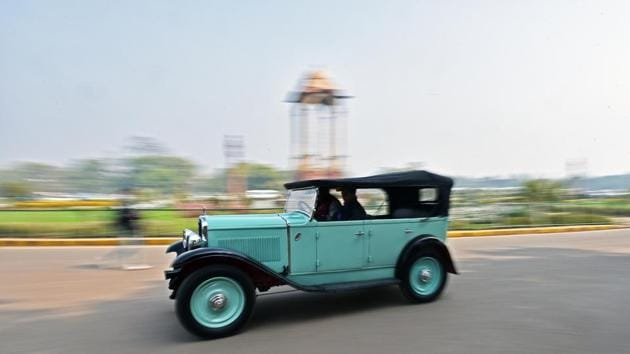 A vintage car cruises by India Gate during the 21 Gun Salute Vintage Car Rally in New Delhi on Saturday, February 17, 2018. (Anushree Fadnavis / HT Photo)