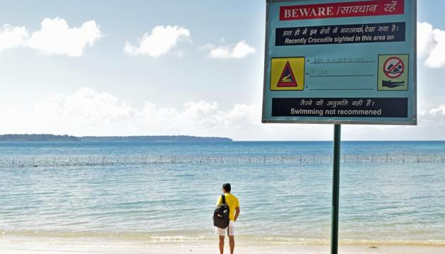 After a croc attack at Wandoor, in November, the 'Safe for Swimming' board was replaced by warning signs. Streams, creeks and coasts in the south Andamans are similarly dotted with signposts that say: 'Never dangle hands or legs during boat rides', 'Please avoid entering into the sea' and even, 'Survivors will be prosecuted'.(Omkar Khandekar)