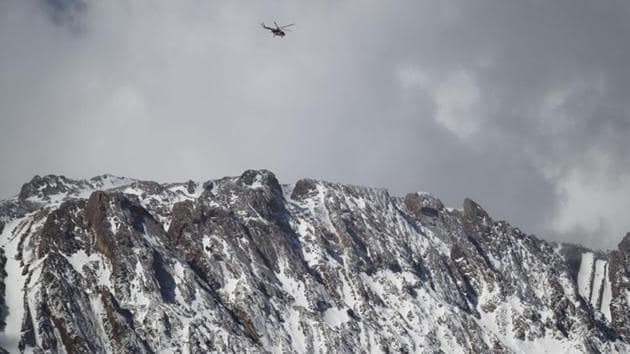 A rescue helicopter searches for the crashed aircraft. Iran has suffered multiple aviation disasters, most recently in 2014 when 39 people were killed as a Sepahan Airlines plane crashed just after take-off. (Tasnim News Agency / REUTERS)