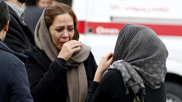 Relatives of Iranian passengers, onboard the Aseman Airlines flight EP3704, in a helpless wait, now entering the third day since the crash. (Atta Kenare / AFP)