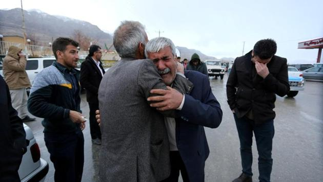 Relatives of passengers who are believed to have been killed in the plane crash near the town of Semirom, Iran. According to the IRNA news agency, families of the passengers had travelled to the area and were giving DNA sample kits for later identification of victims. (Tasnim News Agency / REUTERS)