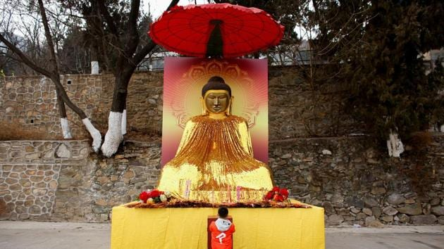 A boy prays at a Buddhist temple in Badachu park during Spring Festival celebrations marking Chinese New Year in Beijing on February 17.(Reuters File Photo)