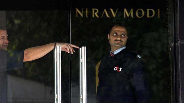 A security guard stands guard inside a Nirav Modi showroom during a raid by Enforcement Directorate.(Reuters File Photo)