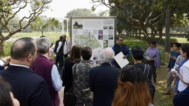 """Ratish Nanda, CEO of the Aga (far, centre) seen explaining the mega renovation plan. """"The site that once served as plant nursery for the British will now serve as Delhi's first arboretum with nearly 300 tree species, the largest number in any of Delhi's parks"""" he said. (Vipin Kumar / HT Photo)"""