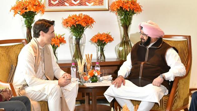 Canadian prime minister Justin Trudeau with Punjab chief minister Amarinder Singh at a hotel in Amritsar on Wednesday.(HT Photo)