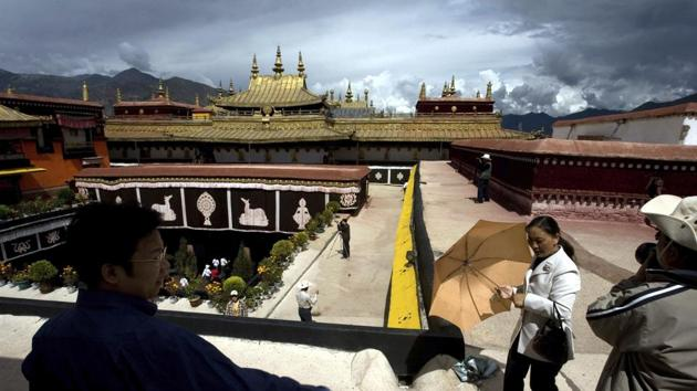 In this July 27, 2007 file photo, tourists are seen visiting the Jokhang Monastery, one of the oldest Tibetan monasteries in Lhasa in China's Tibet Autonomous Region. Chinese authorities say they have ruled out arson as the cause of a fire at the temple on February 17, 2018 that damaged the 1,300-year-old monastery.(AP)