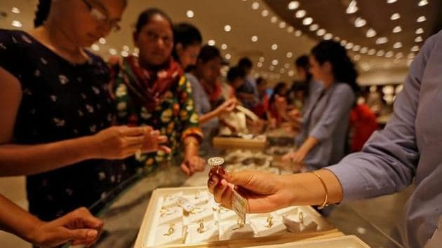 Gold prices slumped on fall in demand from local jewellers and retailers amid a weak trend overseas.(Reuters)