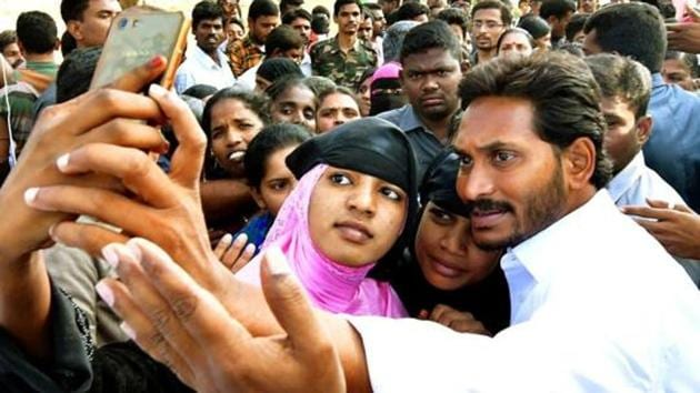 YSR Congress president YS Jaganmohan Reddy poses for a selfie with supporters during a rally in Andhra Pradesh.(PTI File)