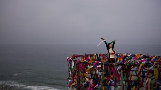 <p>Doyu, 48, an artist, performs at the Goseong Unification Observatory, which is one of the northern most points in South Korea where civilians can travel in...