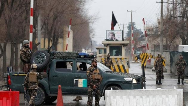 Afghan security forces keep watch at a check point near the site of a suicide attack in Kabul, Afghanistan.(REUTERS Photo)
