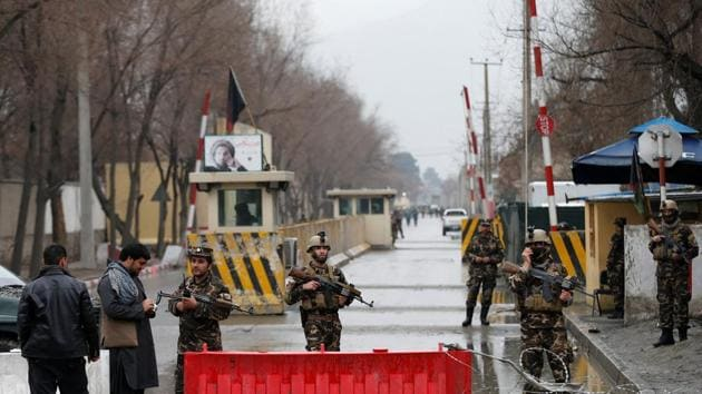 Afghan security forces keep watch at a check point in Kabul on Friday.(REUTERS)