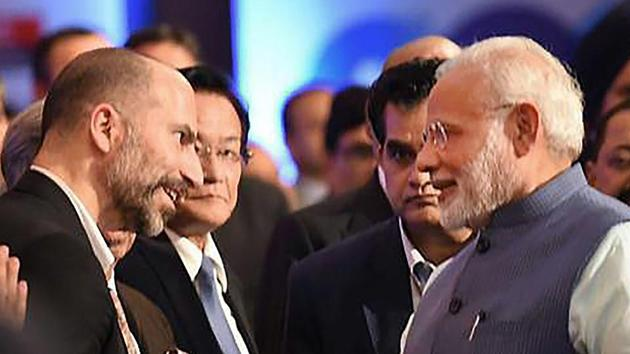 Prime Minister Narendra Modi shakes hands with Uber CEO Dara Khosrowshahi during Global Business Summit, in New Delhi.(PTI Photo)
