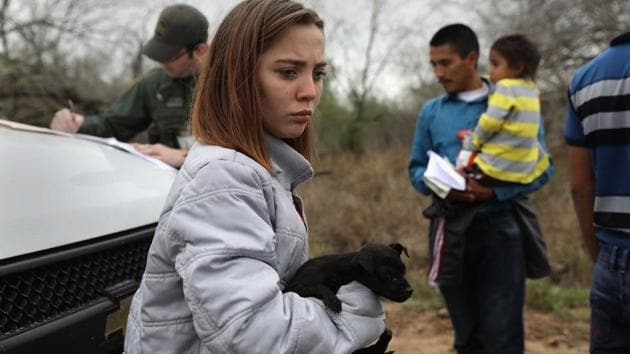 Central American immigrants turn themselves in to Border Patrol agents near McAllen, Texas. The girl, 14, from Honduras said that she had picked up the puppy in Reynosa, Mexico during her journey. Thousands of Central American families continue to enter the US, most seeking political asylum from violence in their home countries. The Rio Grande Valley has the highest number of undocumented immigrant crossings and narcotics smuggling of the entire US-Mexico border.(AFP)