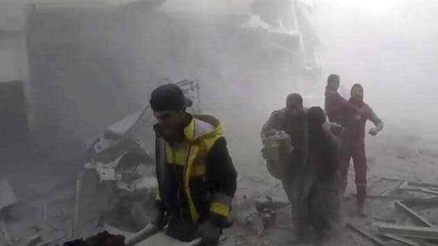 This video grab released on Feb 24, 2018, by the Syrian Civil Defense group known as the White Helmets, shows members of the group help residents during airstrikes and shelling by Syrian government forces, in Ghouta, a suburb of Damascus, Syria.(AP Photo)