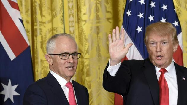 US President Donald Trump (right) and Australian Prime Minister Malcolm Turnbull at a joint press conference in the East Room of the White House in Washington, DC, on Friday.(AFP)