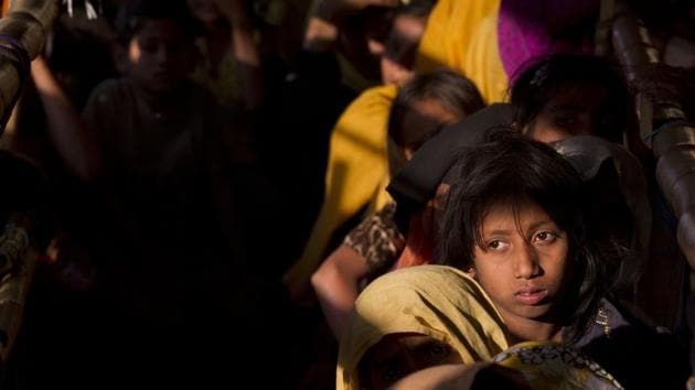Rohingya Muslim women refugees wait in a queue to receive relief material at the Balukhali refugee camp near Cox's Bazar, Bangladesh, Saturday, Jan. 27, 2018. T(AP File Photo)