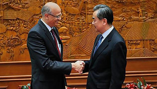 Foreign Secretary Vijay Gokhale shakes hands with Chinese Foreign Minister Wang Yi in Beijing on Friday.(PTI)