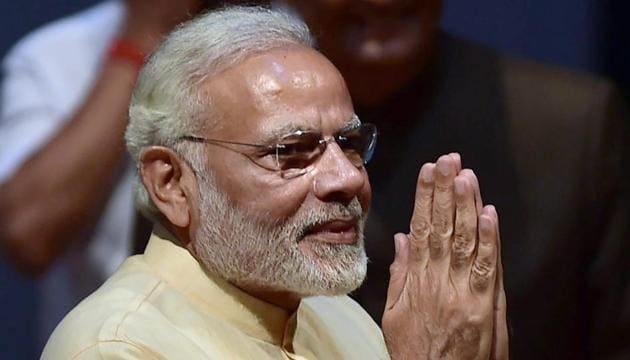 Prime Minister Narendra Modi greets during the Golden Jubilee celebrations of Auroville International township at Villupuram district at Tamil Nadu on Sunday.(PTI Photo)