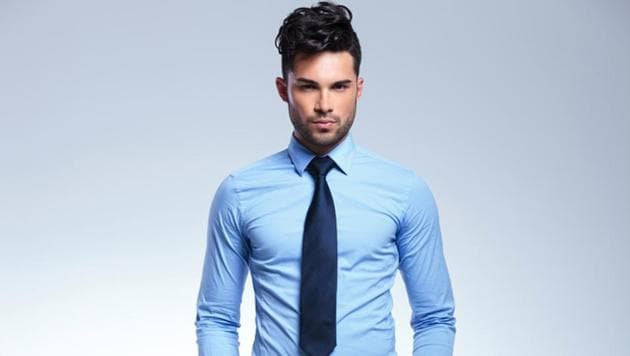 Wear a blue shirt -- just ditch the tie to transform your look for a date night.(Shutterstock)