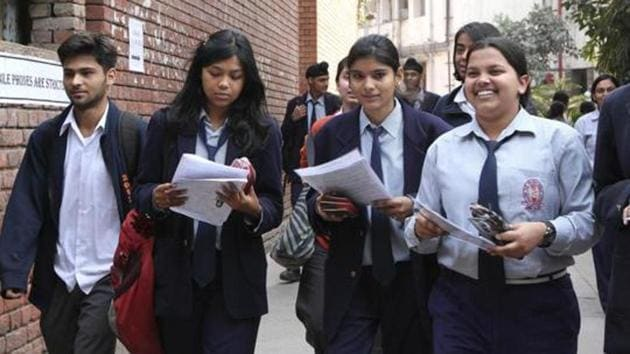 School children coming out after appearing for their Central Board of Secondary Education (CBSE) senior school certificate examinations outside an examination centre at Bhartiya Vidya Bhavan.(HT File Photo)