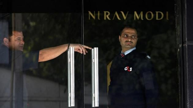 A security guard stands guard inside a Nirav Modi showroom during a raid by the Enforcement Directorate.(REUTERS File Photo)