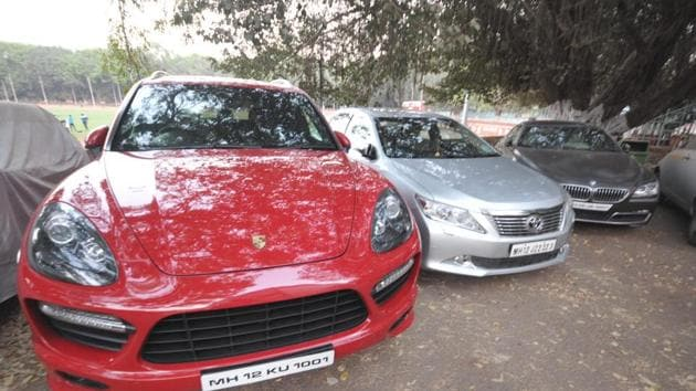 Seized vehicles of DS Kulkarni by police at Shivajinagar Police station in Pune on Monday.(HT PHOTO)