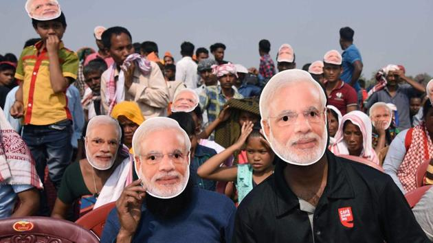 BJP supporters wear masks of Prime Minister Narendra Modi during an election rally at Phulbari in Meghalaya's West Garo Hills recently.(AFP photo)
