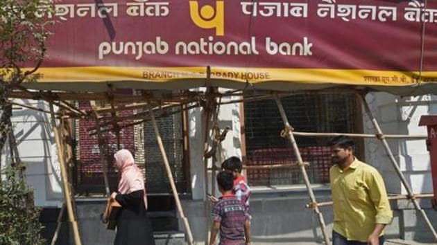 People walk past as the CBI team seals Punjab National Bank's South Mumbai branch at Brady House last week.(PTI File Photo)