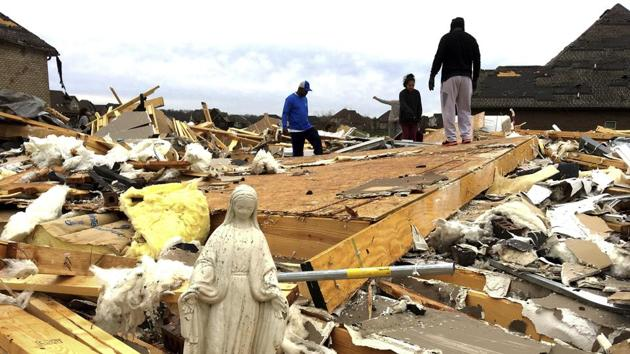 A statue of Mary is among the items volunteers salvaged from the rubble of a destroyed home in Clarksville, Tennessee.(AP Photo)