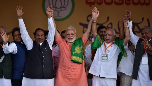 The Prime Minister of India Narendra Modi with Karnataka state President and BJP chief ministerial candidate for upcoming state Assembly election BS Yeddyurappa and K S Eshwarappa during Farmer's Convention in Davangere, India, on Tuesday, February 27, 2018.(Arijit Sen/HT Photo)