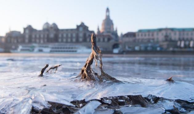 The frozen shore of the Elbe is pictured at sunrise in front of a backdrop of the old town of Dresden, Germany.(AFP Photo)
