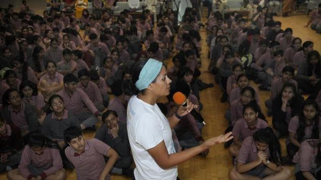 Srishti Bakshi interacts with Genesis Global School students in Noida on Tuesday.(Sunil Ghosh /ht photo)