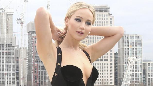 Jennifer Lawrence poses for photographers at the photo call for the film Red Sparrow in London.(Joel C Ryan/Invision/AP)