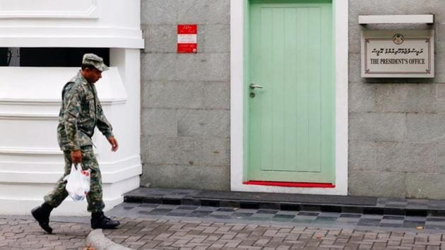 A Maldives National Defence Force soldier walks past the president's office building in Male, Maldives February 6, 2018. Maldives has declined India's invitation to participate in the(Reuters Photo)