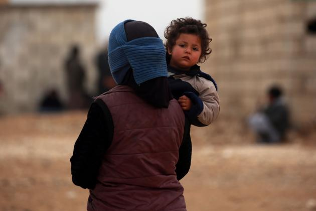 A displaced Syrian who her homes in Deir Ezzor city in the country's northeastern Hassakeh province on February 26, 2018.(AFP / Representative photo)