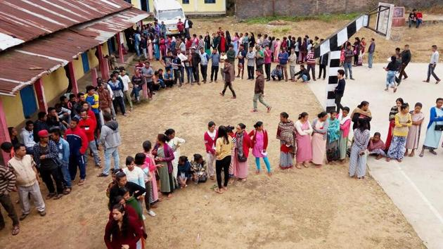 People stand in queues to cast their votes at a polling station in Ri Bhoi district of Meghalaya on Tuesday.(PTI Photo)