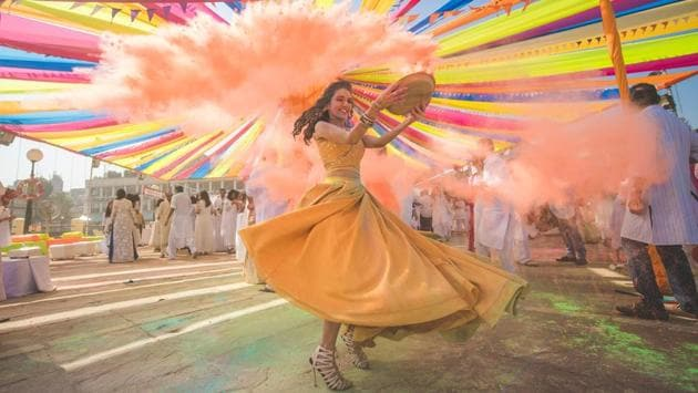 If you're getting married in the months of summer, consider a Holi party instead of a cocktail party — as this Mumbai-based fashion blogger did.(Photo: Instagram/WeddingNama)