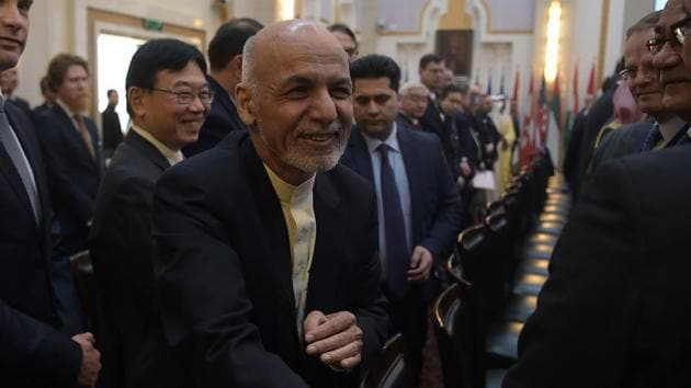 Afghan president Ashraf Ghani shakes hands with a foreign delegate at the second Kabul Process conference at the Presidential Palace in Kabul on February 28, 2018.(AFP Photo)