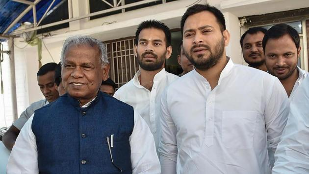 Rashtriya Janata Dal leader Tejashwi Yadav with former Bihar chief minister and Hindustani Awam Morcha (Secular) leader Jitan Ram Manjhi leave after attending a meeting in Patna.(PTI Photo)
