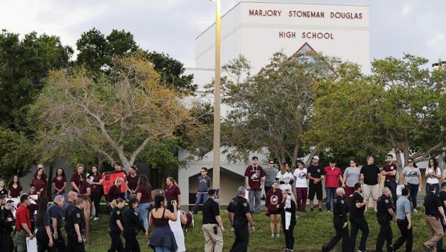 Police walk outside Marjory Stoneman Douglas High School in Parkland, Florida on February 28.(AP Photo)
