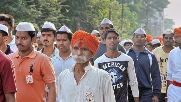 Sambhaji Bhide (foreground, orange turban) is charged with inciting violence at Koregaon Bhima.(HT photo)