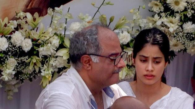 Mumbai: Boney Kapoor with daughter Janhvi seen on the vehicle carrying mortal remains of Sridevi during the funeral procession in Mumbai on Wednesday.(PTI)