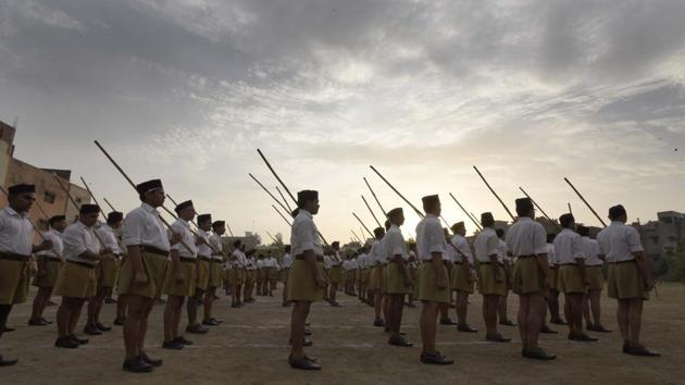 Participants at an RSS camp in New Delhi. Though the RSS maintains it is apolitical, there was convergence between its cadre and the BJP on how to breach the bastions and reach out to people in northeastern states.(HT file photo)